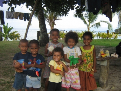 children on beach with toys