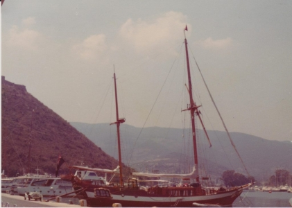 Classic ship in marina surrounded by hills