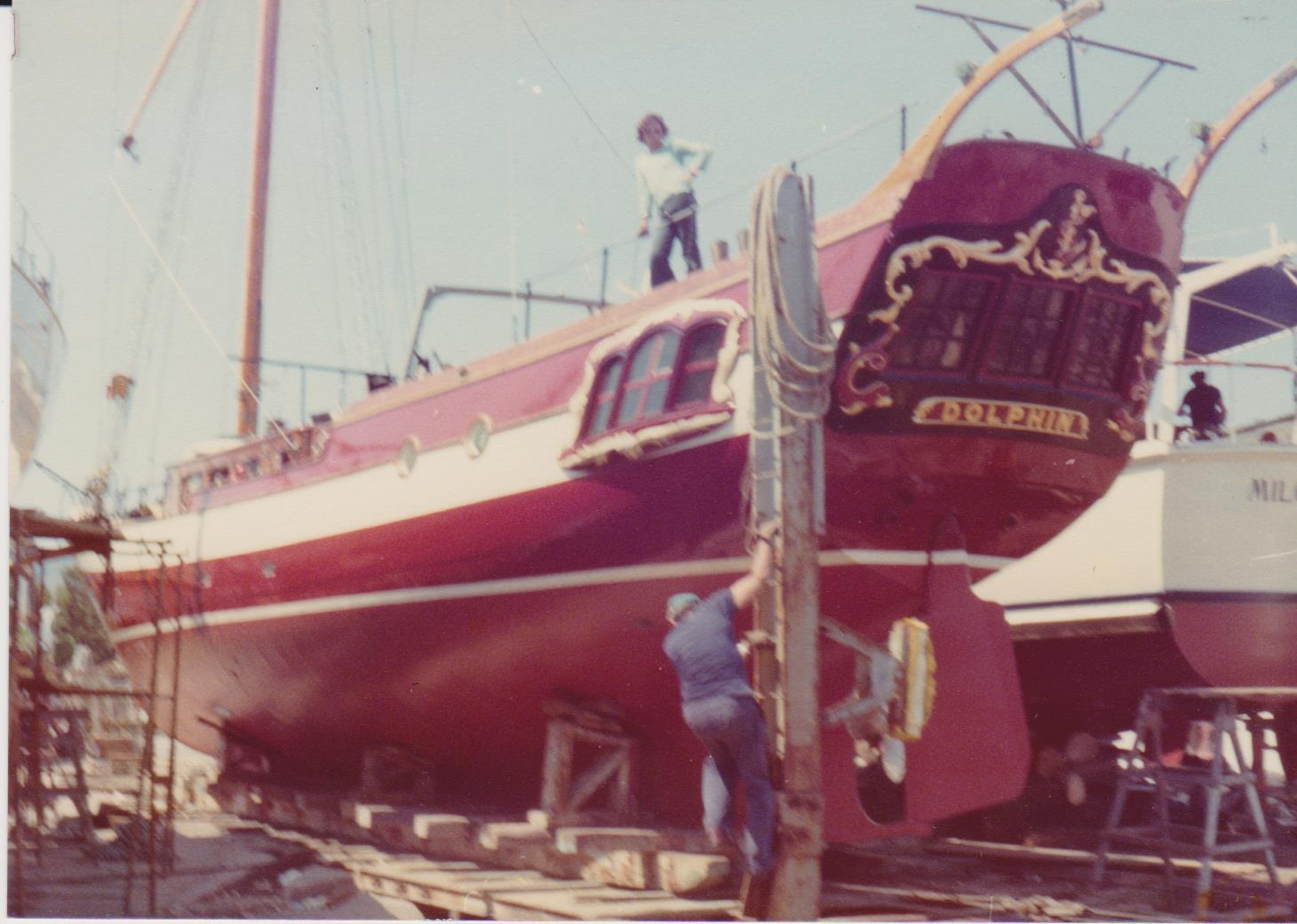 Classic ship on slipway with people